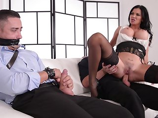 Odd MILF Jasmine Jae ties up a guy and rides him at one's fingertips the office