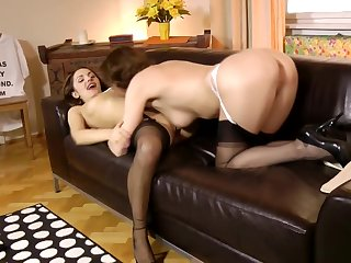 Classy underclothes cougar pleasuring young pussy