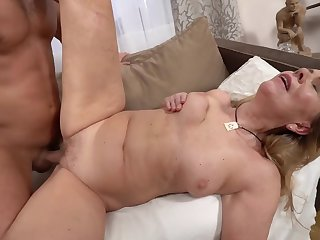 A hot bimbo granny is getting fucked wits a horny younh man
