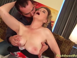 heavy horny mummy gives her young toyboy an extreme hot tit job