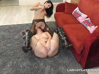 Four lesbians in pantyhose having romantic sex on the red sofa