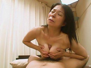 Hairy Japanese grandma Akiko Oda getting one's hands on her back having sex