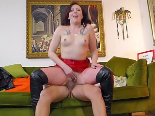 Redhead slut around fishnet stockings gets fucked hard off out of one's mind an doyen clothes-horse